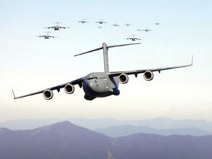 A Formation of 17 C-17 Globemaster IIIs Fly Over the Blue Ridge Mountains by Stocktrek Images