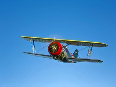 A Grumman F3F Biplane in Flight by Stocktrek Images