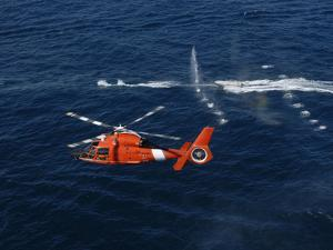 A Helicopter Crew Trains Off the Coast of Jacksonville, Florida by Stocktrek Images