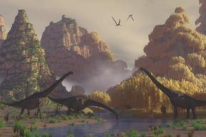 A Herd of Sauroposeidon Dinosaurs Drinking from a River by Stocktrek Images