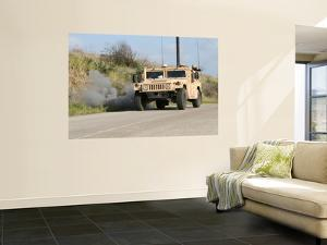 A Mock Improvised Explosive Device Explodes in the Window of a Humvee by Stocktrek Images