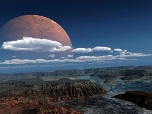 A Moon Rises over a Young World by Stocktrek Images