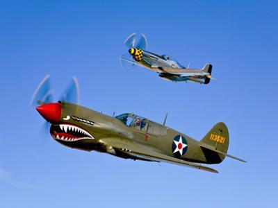 A P-40E Warhawk and a P-51D Mustang Kimberly Kaye in Flight by Stocktrek Images