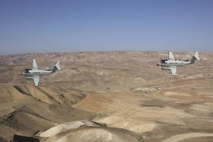 A Pair of Israeli Air Force B-200 Tzofit in Flight over Israel by Stocktrek Images