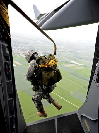 A Paratrooper Executes An Airborne Jump Out of a C-17 Globemaster III