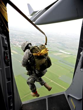 A Paratrooper Executes An Airborne Jump Out of a C-17 Globemaster III by Stocktrek Images