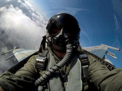 A Pilot in the Cockpit of an F-16 Fighting Falcon by Stocktrek Images