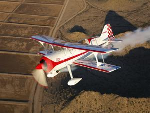A Pitts Model 12 Aircraft in Flight by Stocktrek Images