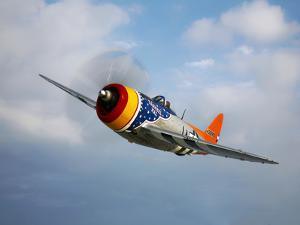 A Republic P-47D Thunderbolt in Flight by Stocktrek Images