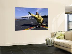 A Shooter Signals the Launch of an F/A-18 Super Hornet by Stocktrek Images
