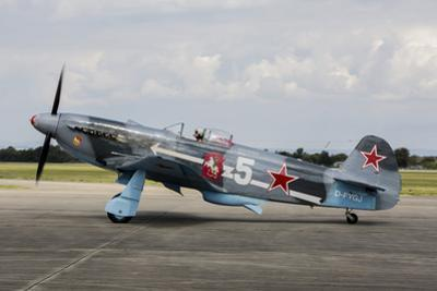 A Soviet Air Force Yak-3 Replica on the Runway by Stocktrek Images