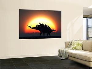 A Stegosaurus Silhouetted Against the Setting Sun at the End of a Prehistoric Day by Stocktrek Images