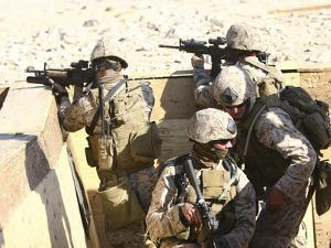 A Team of Recon Marines Assaults a Trench System by Stocktrek Images