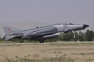 A Turkish Air Force F-4E 2020 Terminator Landing at Konya Air Base, Turkey by Stocktrek Images