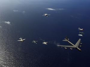 A U.S. Air Force B-52 Stratofortress Aircraft Leads a Formation of Aircraft by Stocktrek Images