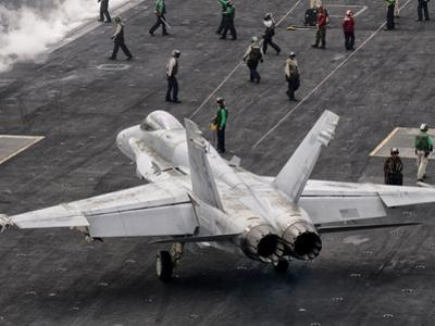 A US Navy F/A-18C Hornet on the Flight Deck of Aircraft Carrier USS Eisenhower by Stocktrek Images