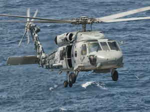 A US Navy SH-60F Seahawk Flying Off the Coast of Pakistan by Stocktrek Images