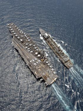 Aerial View of Aircraft Carrier USS Ronald Reagan And USNS Bridge During a Replenishment at Sea by Stocktrek Images