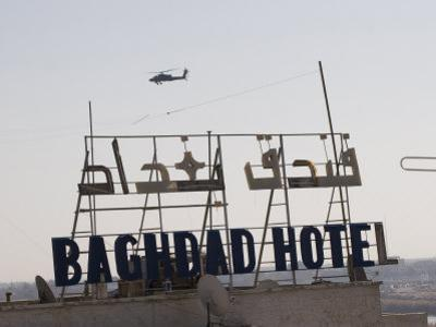 AH-64 Apache in Flight over the Baghdad Hotel in Central Baghdad, Iraq