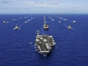Aircraft Carrier USS Ronald Reagan Transits the Pacific Ocean with a Fleet of Ships by Stocktrek Images
