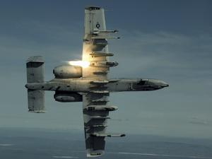 An A-10 Warthog Breaks Over the Pacific Alaska Range Complex During Live Fire Training by Stocktrek Images