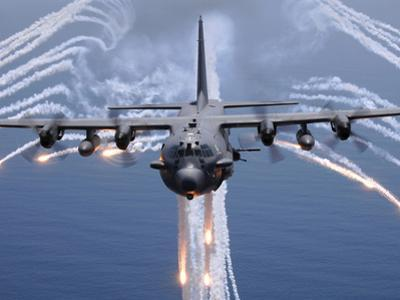 An AC-130H Gunship Aircraft Jettisons Flares As An Infrared Countermeasure by Stocktrek Images