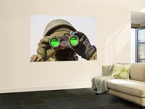 An Afghan Soldier Scans the Horizon for Enemy Movements by Stocktrek Images