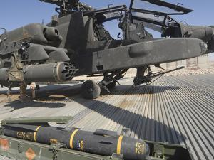 An AGM-114 Hellfire Missile Is Ready to Be Loaded onto an AH-64 Apache by Stocktrek Images