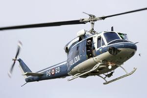 An Agusta Bell 212 of Italy's State Police in Flight over Italy by Stocktrek Images