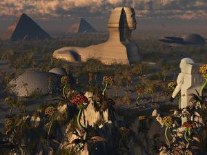 An Astronaut Explorer Comes across Familiar Structures on an Alien Landscape by Stocktrek Images