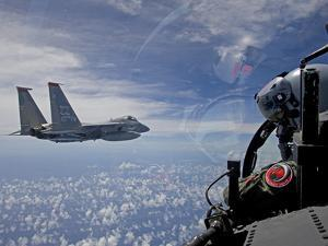 An F-15 Eagle Pilot Flies in Formation with His Wingman by Stocktrek Images