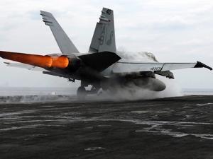An F/A-18C Hornet Launches from the Flight Deck Aboard USS Enterprise by Stocktrek Images