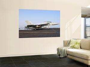 An F/A-18E Super Hornet Lands Aboard Uss Harry S. Truman by Stocktrek Images
