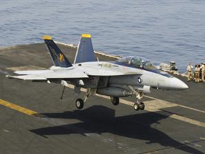 An F/A-18E Super Hornet Trap Landing on the Flight Deck of USS Harry S. Truman by Stocktrek Images