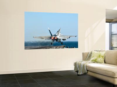 An F/A-18F Super Hornet Launches from the Flight Deck of Aircraft Carrier Uss Nimitz by Stocktrek Images