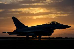 An Italian Air Force F-2000 Typhoon at Sunset by Stocktrek Images
