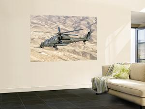 An Italian Army Aw-129 Mangusta over Afghanistan by Stocktrek Images