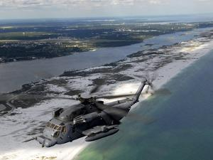 An MH-53 Pave Low Flies Over the Coastline of Florida by Stocktrek Images