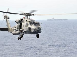 An MH-60R Seahawk Helicopter in Flight over the Pacific Ocean by Stocktrek Images