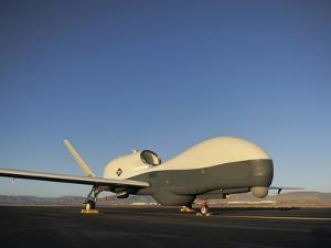 An RQ-4 Global Hawk Unmanned Aerial Vehicle Sits On the Flight Line by Stocktrek Images