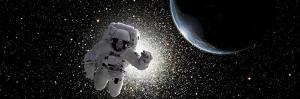 Astronaut Floating in Deep Space with an Earth-Like Planet in Background by Stocktrek Images