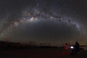 Astronomer with Telescope Looking at the Milky Way in the Atacama Desert, Chile by Stocktrek Images