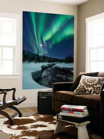 Aurora Borealis over Blafjellelva River in Troms County, Norway by Stocktrek Images