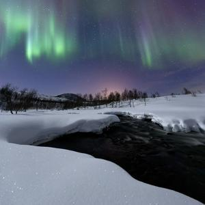 Aurora Borealis over Blafjellelva River in Troms County by Stocktrek Images