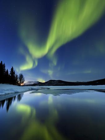 Aurora Borealis over Sandvannet Lake in Troms County, Norway