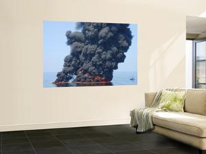 Dark Clouds of Smoke and Fire Emerge as Oil Burns During a Controlled Fire in the Gulf of Mexico by Stocktrek Images