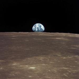 Earth Rising Above the Moon's Horizon by Stocktrek Images