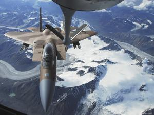 F-15C Eagle Aircraft from behind a KC-135R Stratostanker over the Pacific Alaskan Range by Stocktrek Images
