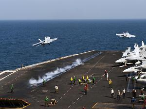 F/A-18F Super Hornets Launch Simultaneously from the Aircraft Carrier USS John C. Stennis by Stocktrek Images