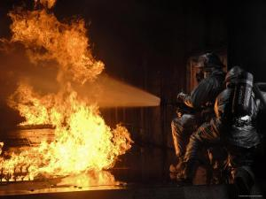 Firefighters Extinguishing a Simulated Battery Fire by Stocktrek Images